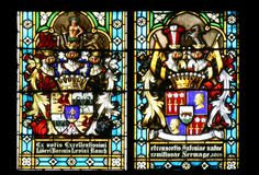 Coat of arms of Baroness Antony Sermage and Baron Levin Rauch. Stained glass in Zagreb cathedral Royalty Free Stock Image