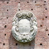 Coat of arms bas-relief on the wall of Sforza castle in Milan, Italy. Stock Image