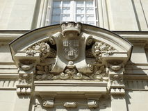 Coat of arms of Chinon. Detail above the front door of a house: coat of arms Chinon with decorations Royalty Free Stock Photo