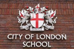 Coat of arms of City of London on facade of City of London School, London, United Kingdom Stock Images