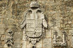 Coat of arms depicted at the exterior wall of the Ozama fortress in Santo Domingo, Dominican Republic. Royalty Free Stock Images