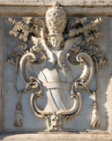 Coat of arms. On the facade of San Giovanni cathedral in Rome Stock Photo
