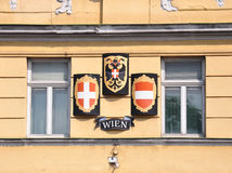Coat of arms and flag of Vienna and Austria. Colorful and crisp image of coat of arms and flag of Vienna and Austria at facade in Vienna Stock Photo
