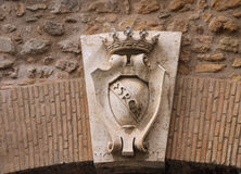 Coat of arms on a gate in the wall around the Vatican. Rome, Italy royalty free stock photography