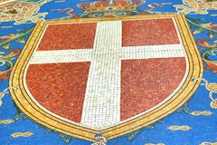 Galleria Vittorio Emanuele II beautiful mosaics Milan Italy. The coat of arms of the House of Savoy innGalleria Vittorio Emanuele II .On the ground of the royalty free stock photo
