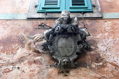 The coat of arms on the house Royalty Free Stock Photo