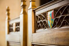 Coat of arms inlaid in some intricate wood carving in a chair ma Royalty Free Stock Photography