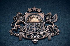 Coat of Arms of Latvia. Bronze symbol of the State of Latvia on a granite surface Stock Photos