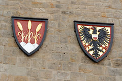 Coat of arms. Left - the coat of arms of the free city of Dinkelsbuhl, an old medieval town in Germany; Right - the imperial coat of arms Stock Images