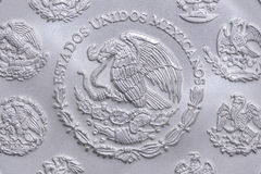 Coat of arms of Mexico on silver coin. Macro closeup of coat of arms of Mexico on reverse side of Mexican silver bullion libertad coin Royalty Free Stock Photo