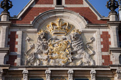 Coat of Arms of the Netherlands. On Amsterdam Central Train Station facade Royalty Free Stock Photos