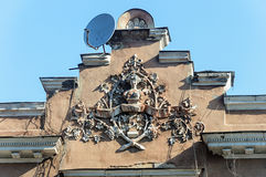 Coat of arms on the old building. Coat of arms on the pediment of old building in Odessa, Ukraine Stock Photos