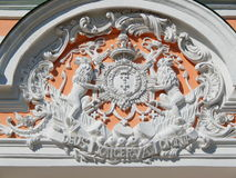 The coat of arms on the Orangerie in the Architectural Park Ensemble Kuskovo, Moscow. Built in the 18th century and belonged to the Sheremetev family Royalty Free Stock Images