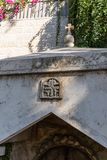 Coat of arms on the place of worship in the courtyard of Church of Mary Magdalene in Jerusalem, Israel. Jerusalem, Israel, November 17, 2018 : Coat of arms on royalty free stock image