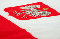 Coat of arms of Poland on a flag. Close up of a Polish flag Stock Image