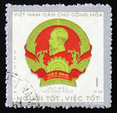 Coat of arms and portrait of Ho Chi Minh, circa 1974 Royalty Free Stock Photo