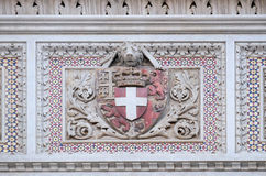 Coat of arms of prominent families, Florence Cathedral. Coat of arms of prominent families that contributed to the facade, Portal of Cattedrale di Santa Maria Royalty Free Stock Photography