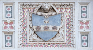 Coat of arms of prominent families, Florence Cathedral. Coat of arms of prominent families that contributed to the facade, Portal of Cattedrale di Santa Maria Royalty Free Stock Photo