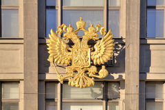 Coat of arms of Russia. Official symbol of Russia on the facade of building of State Duma stock photography