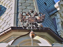 Russian state coat double-headed eagle. Old Russian coat of arms  at the Yalta chapel in Crimea on the Black sea coast Royalty Free Stock Image