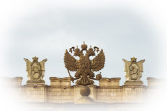 Coat of arms Russia. N Federation. Coat of arms on background of parapet administrative building government with USSR symbols. Photo with vignetting effect Royalty Free Stock Photography