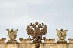 Coat of arms Russia. Coat of arms of the Russian Federation. Coat of arms  on the background of the parapet of the administrative government building with Soviet Royalty Free Stock Photography