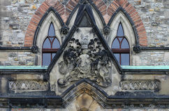 Coat of Arms sculpture above the entrance of East Block Parliament Buildings. Ottawa, Canada Stock Photography