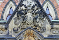 Coat of Arms sculpture above the entrance of East Block Parliament Buildings. Ottawa, Canada Stock Photo