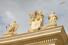 Coat of arms and statues in the Vatican. Rome, Italy Stock Image