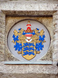 Coat of arms of Tallinn. Medieval heraldry on the front wall of city hall Royalty Free Stock Photo