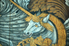 Coat of Arms Unicorn. Detail of a coat of arms painted in 1803 by an anonymous artist. The coat of arms forms part of a hatchment - used to decorate a church Royalty Free Stock Images