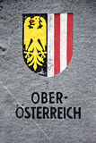 Coat of arms of Upper Austria. (Oberosterreich) engraved on a stone wall Royalty Free Stock Photo