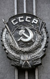 Coat of arms of the USSR. On the facade of the old building Stock Photo