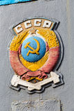 Coat of arms the USSR obsolete railroad car. The coat of arms of the Soviet Union aboard obsolete railroad car Royalty Free Stock Photography