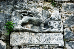 Coat of arms of the Venetian Republic. The old coat of arms of the Republic of Venice on the fortress wall in Kotor, Montenegro Stock Photo