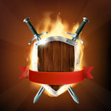 Coat of arms, a wooden shield with swords and ribbon on fire. St Stock Images