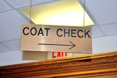 Coat check sign. Coat check sign placed in a business establishment ine Stock Photo