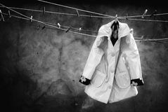 Coat on clothes line Royalty Free Stock Photos