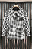 Coat on clothes rack Royalty Free Stock Image