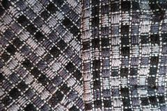 Coat fabric in shades of grey. From above Stock Photos