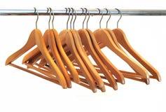 Coat Hanger. Wood coat hanger at a wardrobe isolated on white Stock Images