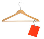Coat hanger and blank price tag Royalty Free Stock Images