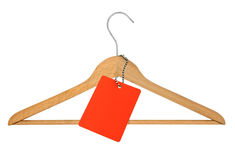 Coat hanger and blank price tag Royalty Free Stock Photography