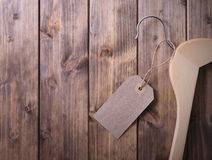 Coat hanger with blank tag Royalty Free Stock Image