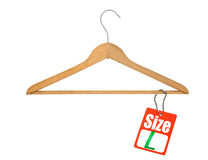 Coat hanger and L size tag Royalty Free Stock Photography