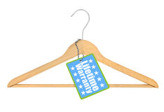 Coat hanger with lifetime warranty tag Stock Image