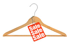 Coat hanger and sale tag Royalty Free Stock Photography