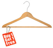 Coat hanger and sale tag Royalty Free Stock Image