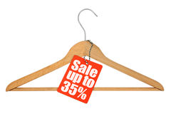 Coat hanger and sale tag Royalty Free Stock Images