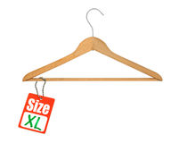 Coat hanger and XL size tag. On white Royalty Free Stock Images
